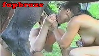 Great couple sucks a horse porn dick outside